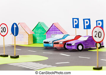 Paper cars models standing in a row on the parking - Three...