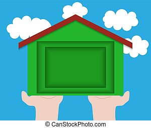 Paper carving of house on the palms against the sky with clouds, ecology idea. Concept of ecological construction.