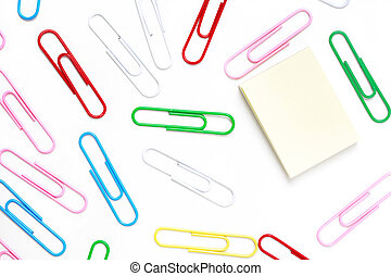 Paper-clip background with postit