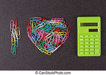 Paper clips are lined in the shape of a heart