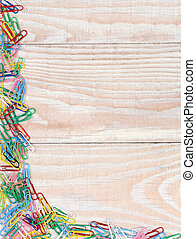 Paper Clips on Wood Background