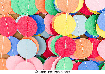 Making a colorful paper garland with reound puncher.