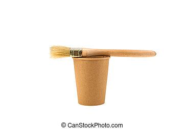 Paper cup and paint brush isolated on white background