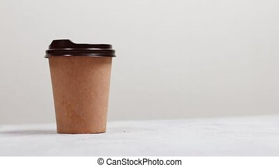 Paper cup of hot coffee with plastic lid to charge energy isolated on light grey background.