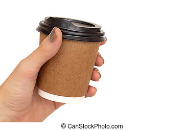 Paper cup with coffee in female hand on white background.