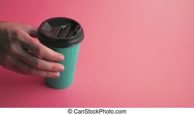 Paper cups on pink background, turquoise color, copy space...