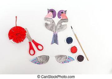 Paper cut bullfinch bird craft for children. Winter holiday Home decoration.