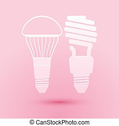 Paper cut Economical LED illuminated lightbulb and fluorescent light bulb icon isolated on pink background. Save energy lamp. Paper art style. Vector