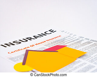 Paper cut home on a house insurance document.