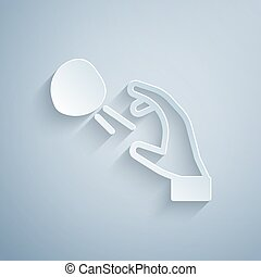 Paper cut Hooligan shooting small stones icon isolated on grey background. Demonstrator. Paper art style. Vector