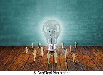 Paper cut of business people and light bulb - Paper cut of...