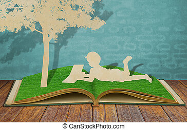 Paper cut of children read a book under tree on old book - ...