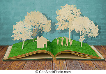 Paper cut of family symbol on old grass book ( House, Tree, Mom, Dad, Child )