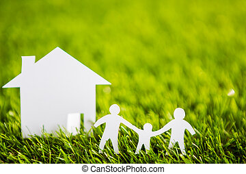 Paper cut of family with house and tree on fresh spring...