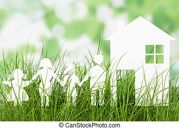 Paper cut of family with house on grass - Paper cut of...