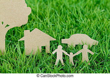 Paper cut of family with house , tree and car on fresh...