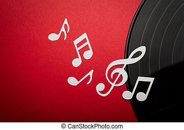Paper cut of music note on Black vinyl record lp album disc...