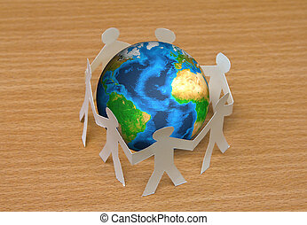 Paper cut of people standing in a circle around globe on wooden