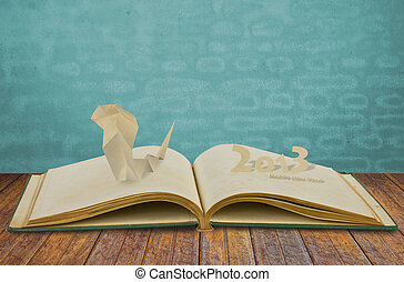 Paper cut of Year of the snake 2013 on old book
