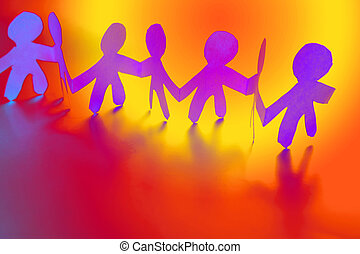 Colorful paper doll people holding hands