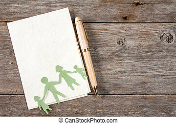 Paper family and paper sheet with a pen
