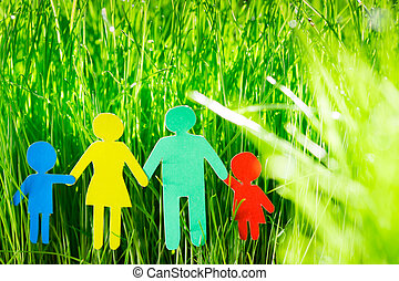 Paper family in grass