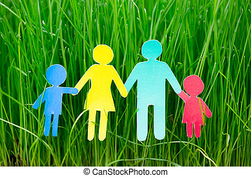 Paper family on grass