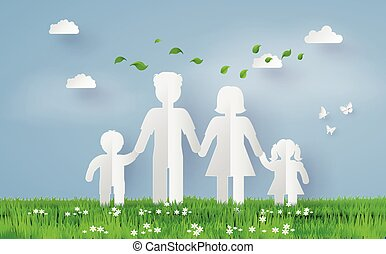 paper family on the grass fiel