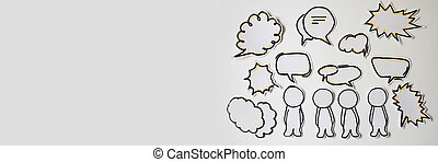 Paper figures with speech bubbles on the white