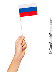 Paper flag of Russian Federation in woman's hand