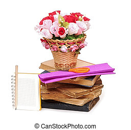 Paper flower in a basket with blank note book