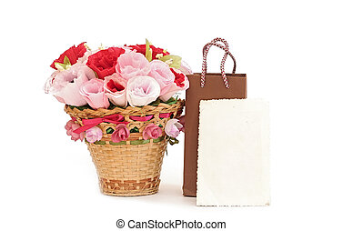 Paper flower in a basket with blank old photo frame