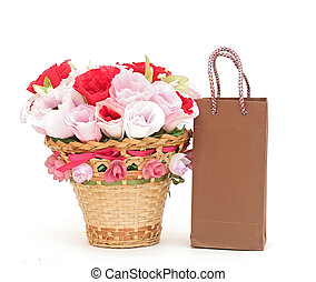 Paper flower in a basket with shopping bag