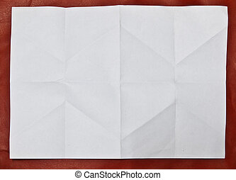 The fold the paper on red background