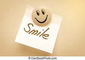 Paper for notes with the word smile on the magnet is toned.