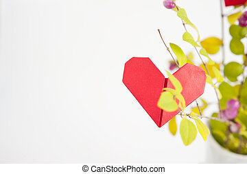 Paper heart on a tree