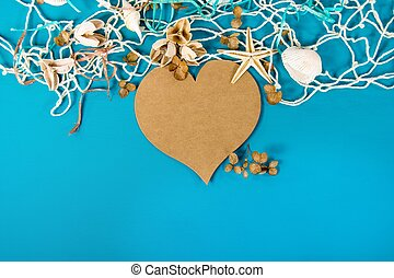 paper heart with seashells