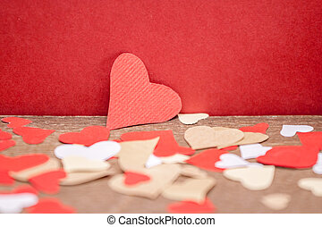 paper hearts on red background