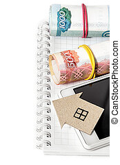 Paper Hous, Russian money, mobile phone and notepad. Vertical edge