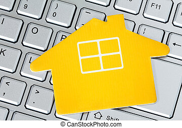 Paper house icon on the computer keyboard