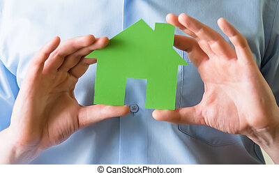 Paper house in the hands