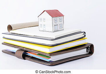 Paper house on Books stack