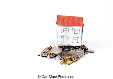 Paper house on coins stack for mortgage loans concept