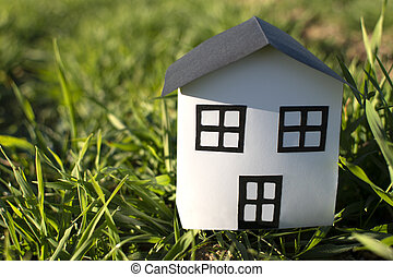 Paper house on the grass
