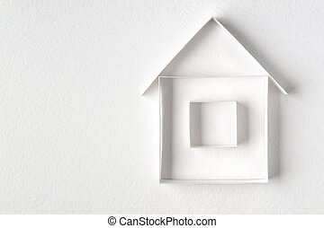Paper house on white background