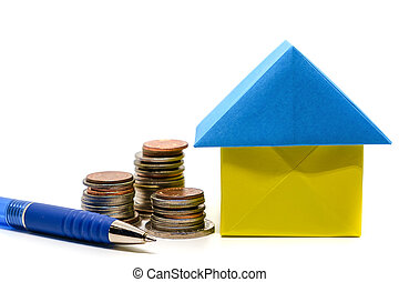 Paper house origami, money coins and a pen on white background