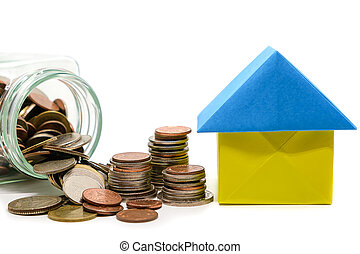 Paper house origami with money coins in the glass jar on white background