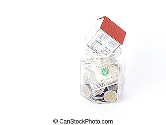 Paper house put on bottles glass for Mortgage loans concept