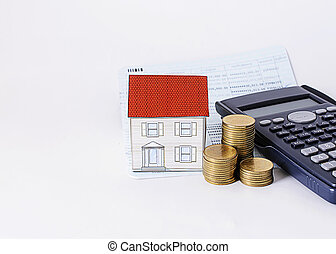 paper house with coins stack with calculator and saving passbook