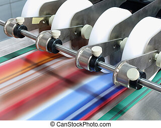 paper in a postpress folder station moving fast, situated in a printer work shop
